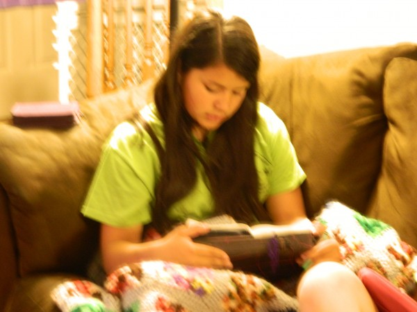 Lydia reading her Bible.
